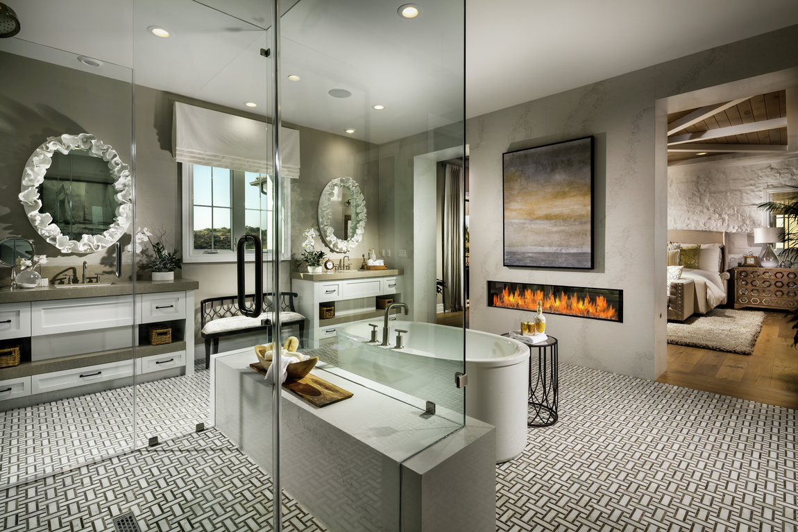Innovative primary bathroom with luxe linear fireplace