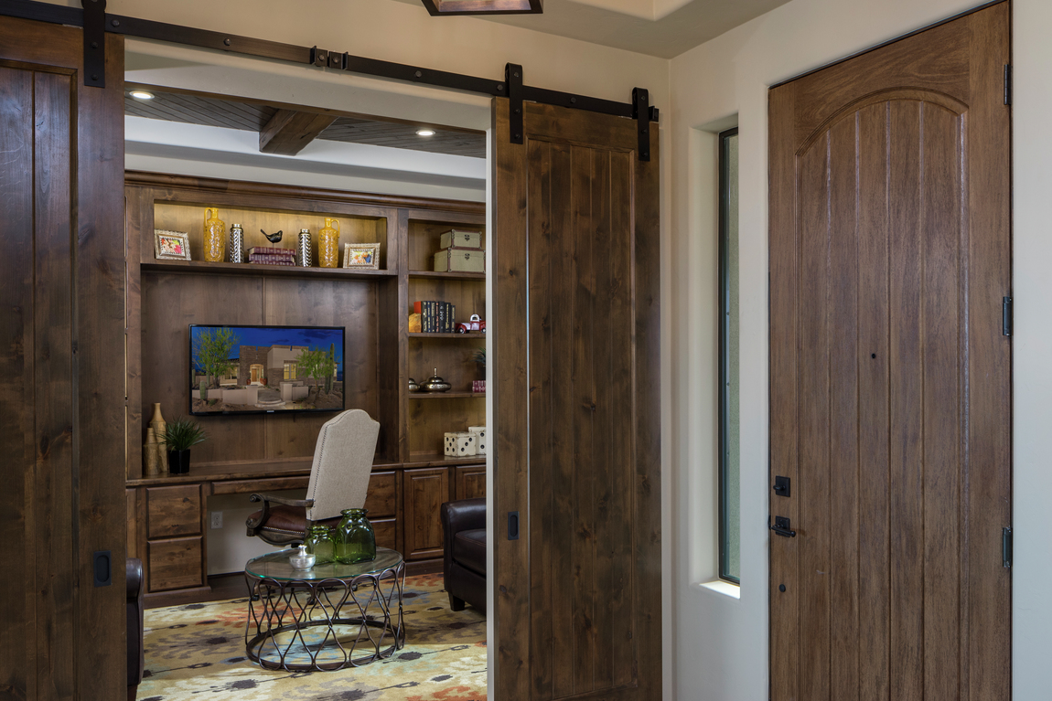 Barn door in a home office that matches the home's front door.