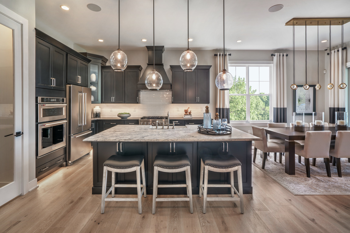 Kitchen design featuring ample storage space and black color scheme