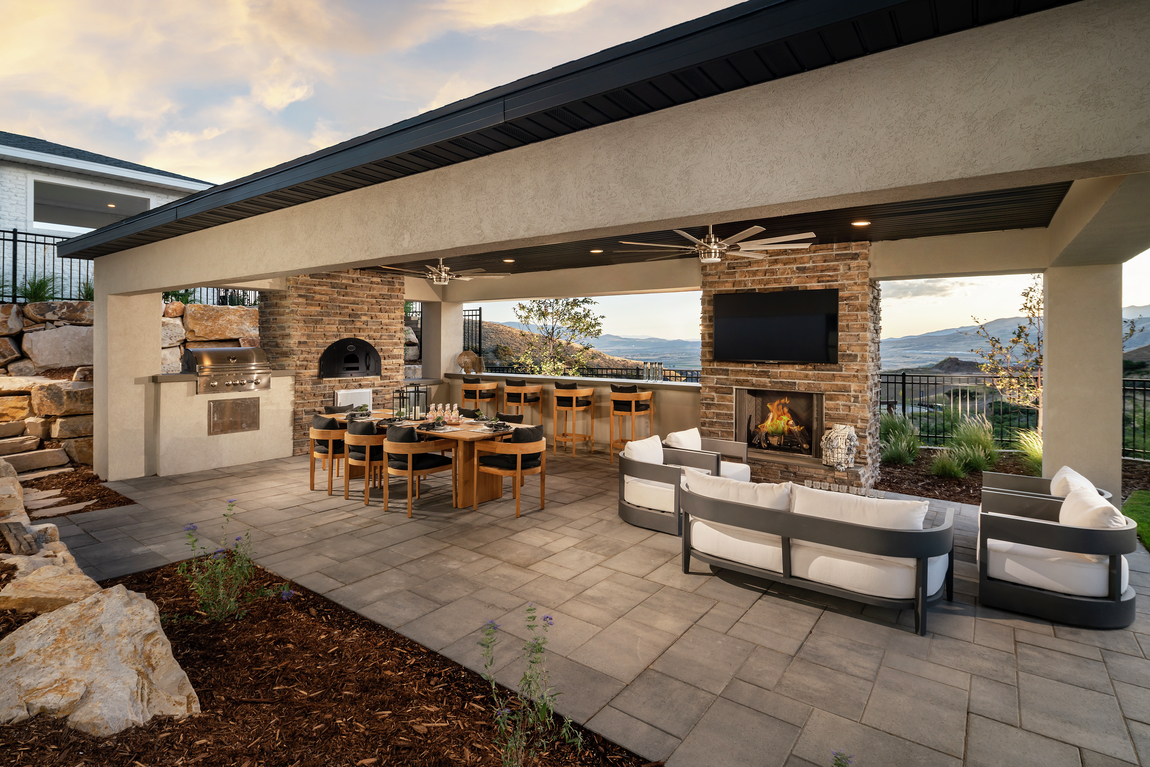 Spacious outdoor patio with luxe fireplace design