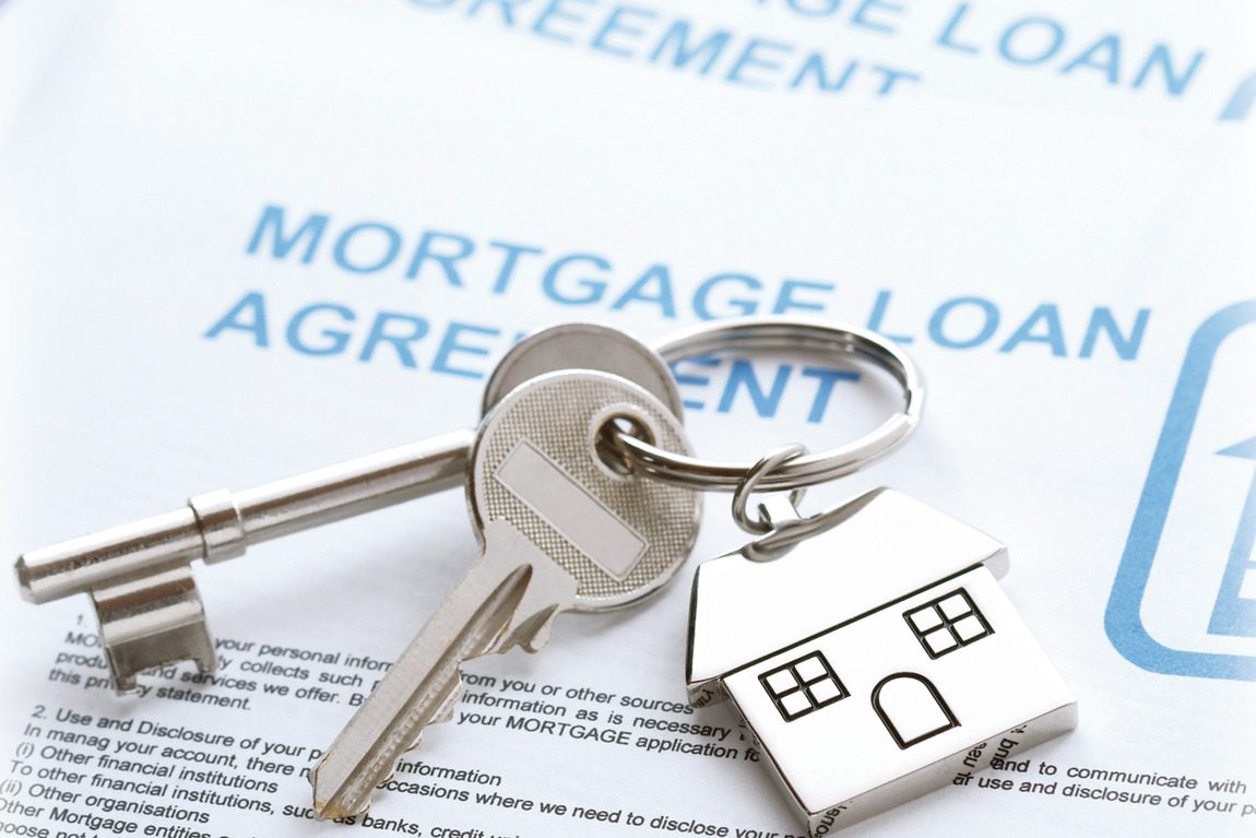 mortgage document and keys to new home
