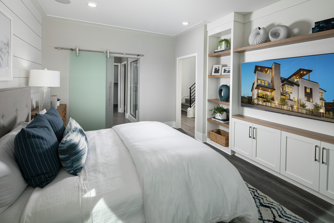 A bedroom with a frosted glass barn door.