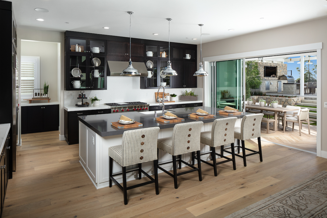 Kitchen in a new construction home with a sliding door that leads to an outdoor space.