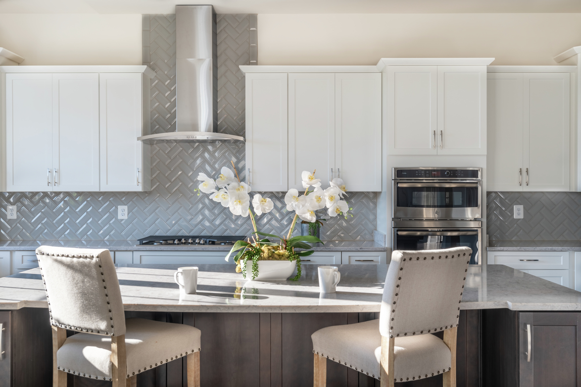 kitchen with monochrome décor and gray backsplash