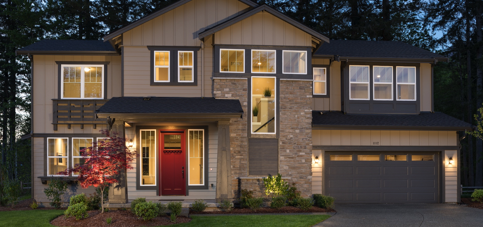Suburban new construction home with a red front door.