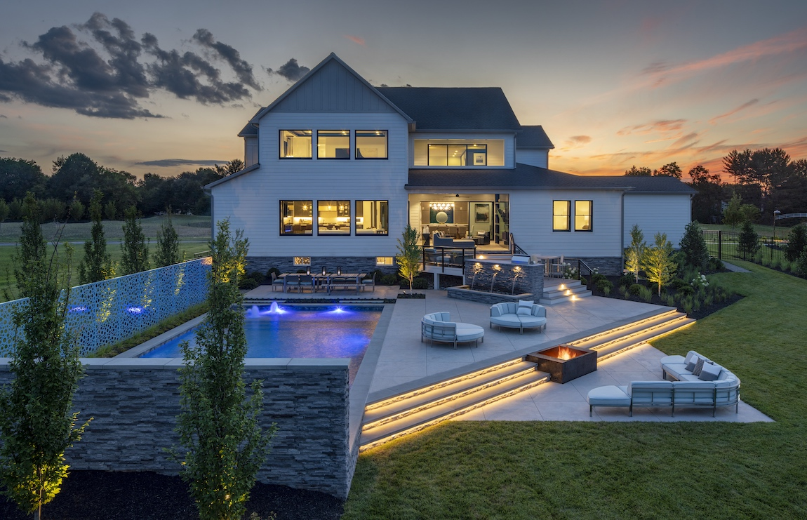 View of a large backyard in Virginia with a pool and a large deck for outdoor living.