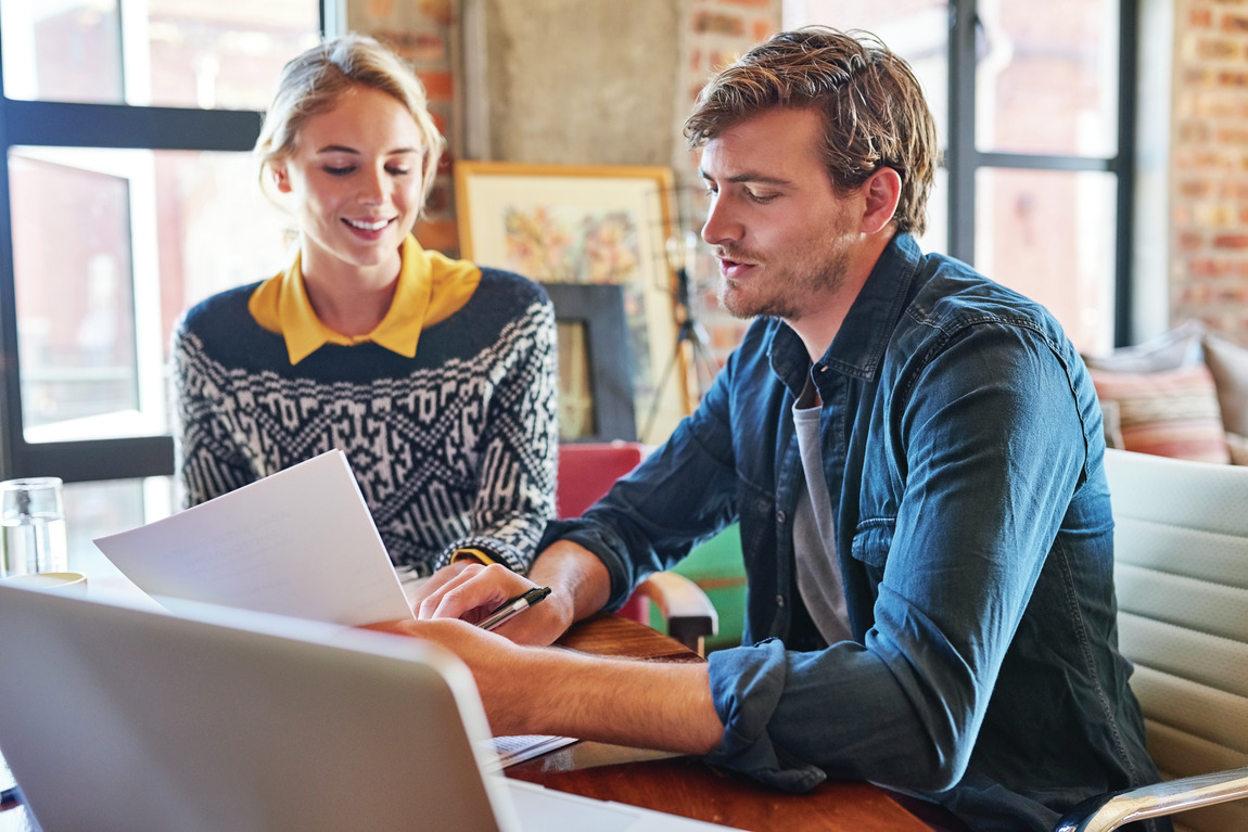 Couple researching questions to ask a mortgage lender