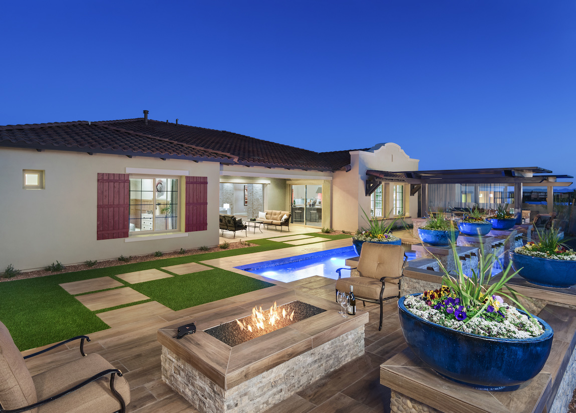 Luxury backyard with a pool, a built-in fire pit and sitting area.