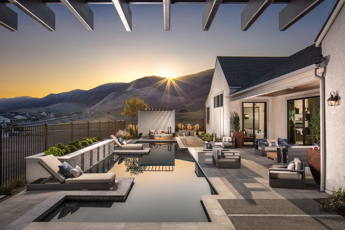 A narrow pool is a backyard in Reno with views of the mountains.