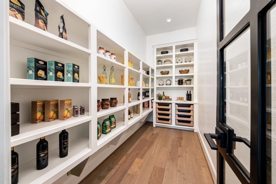 Modern walk-in [pantry with ample cabinet space for food storage