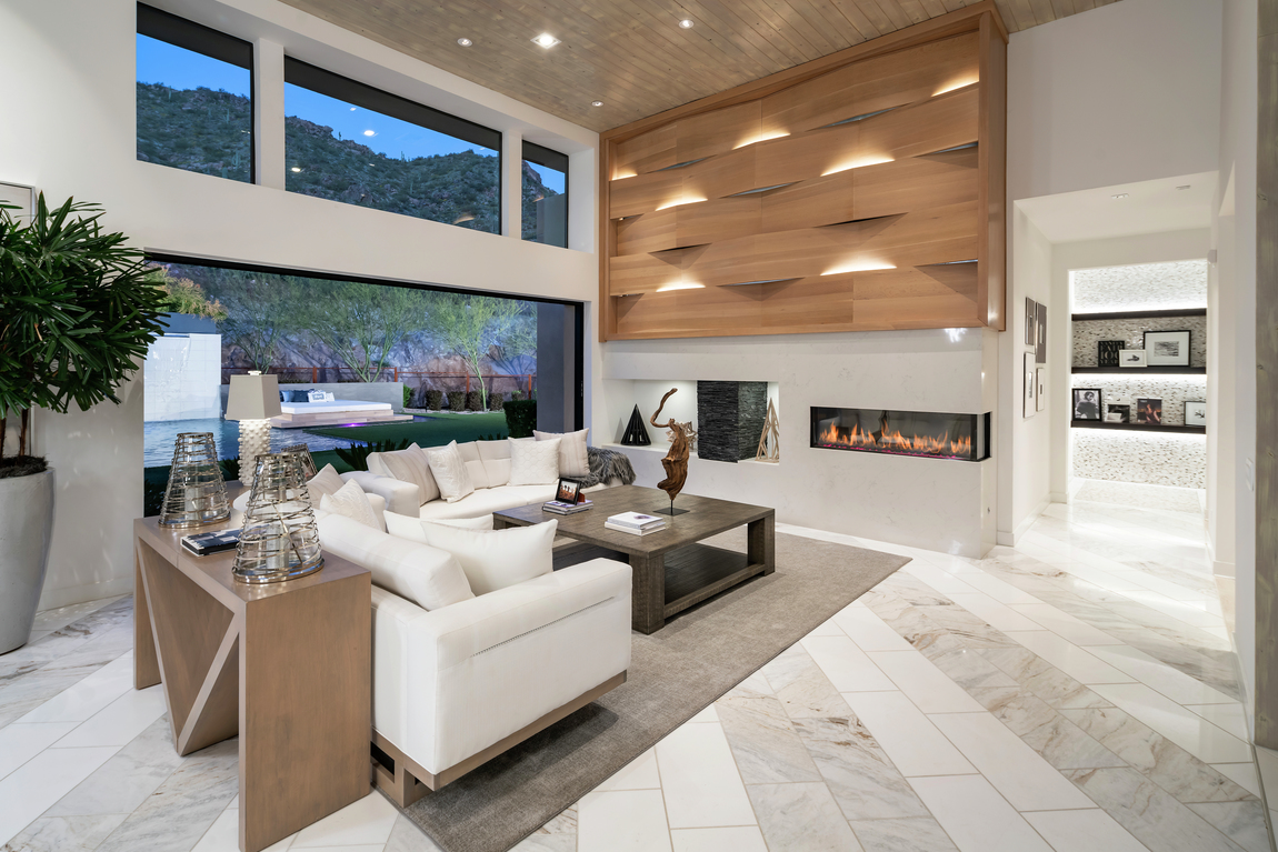 Minimalist modern great room with linear fireplace