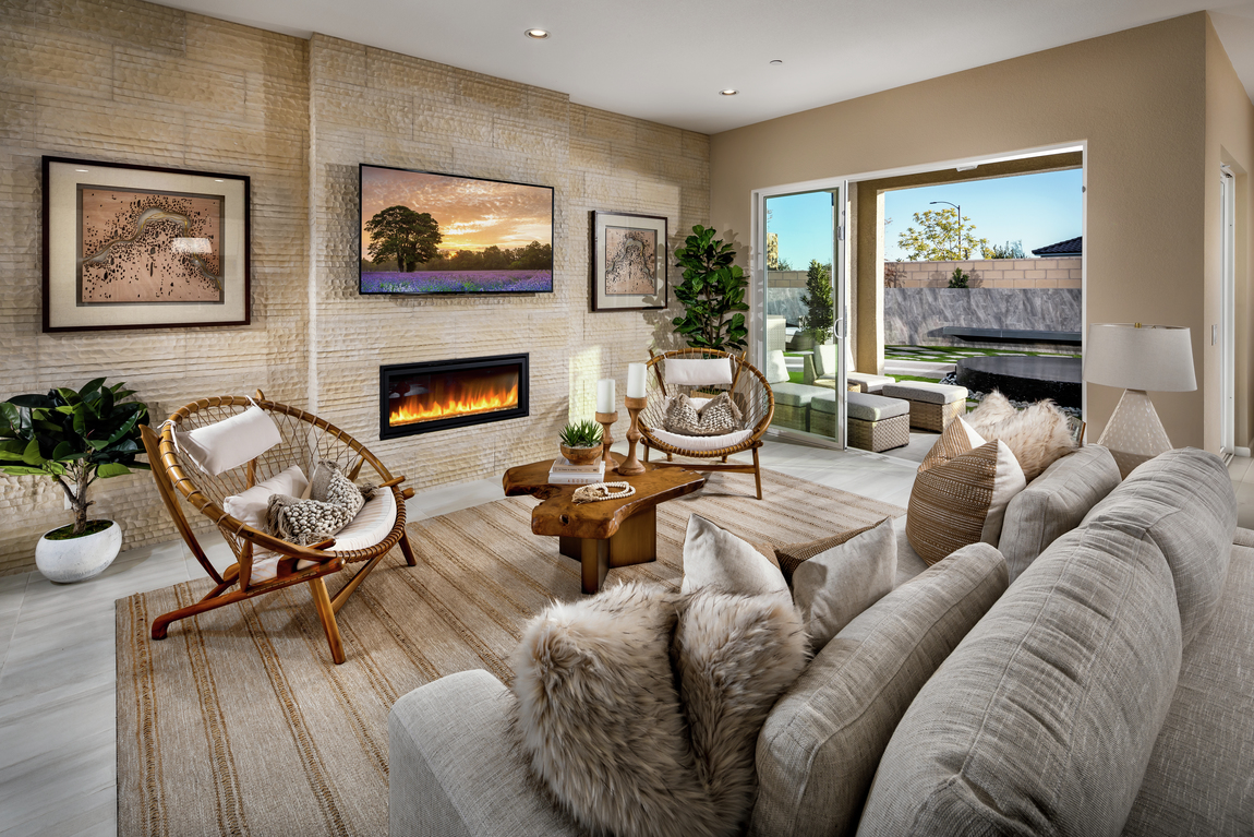 A modern linear fireplace in a luxury living room.