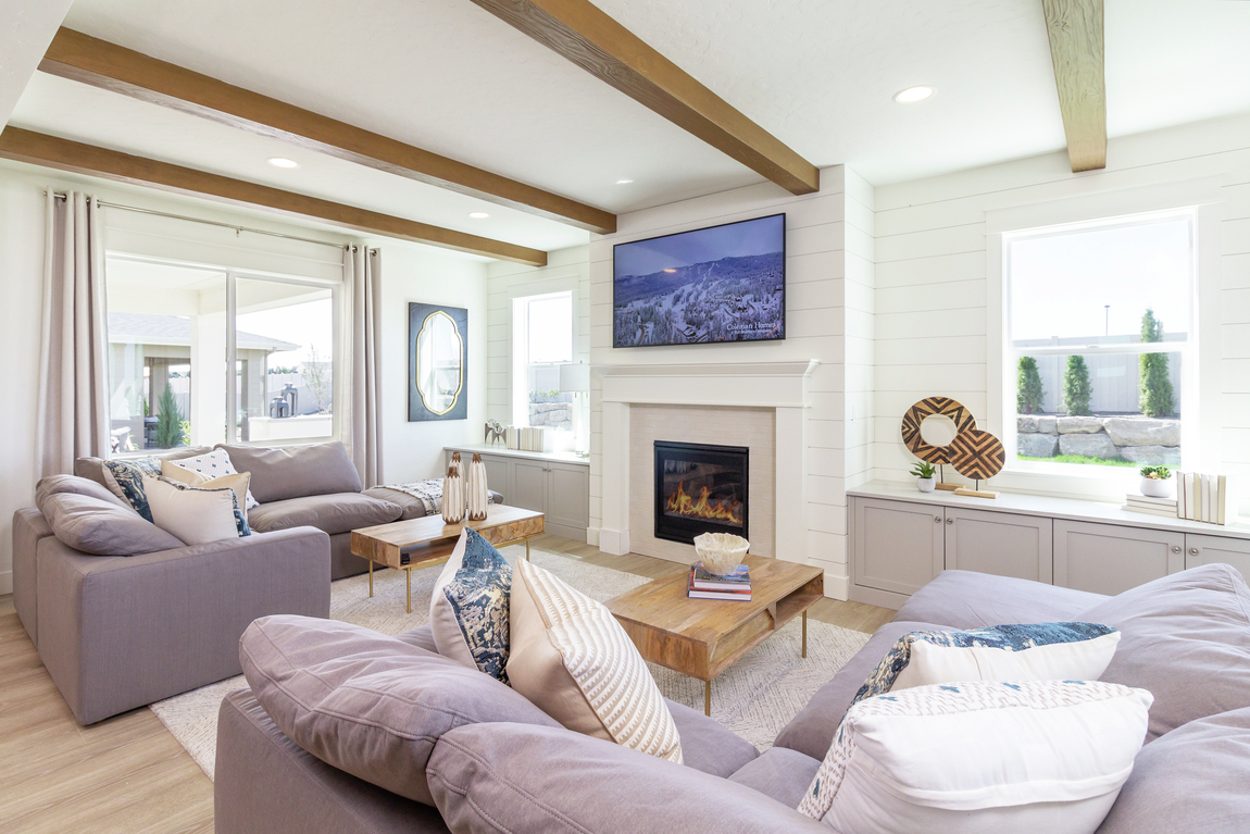 A traditional fireplace place and mantle surrounding by white shiplap.