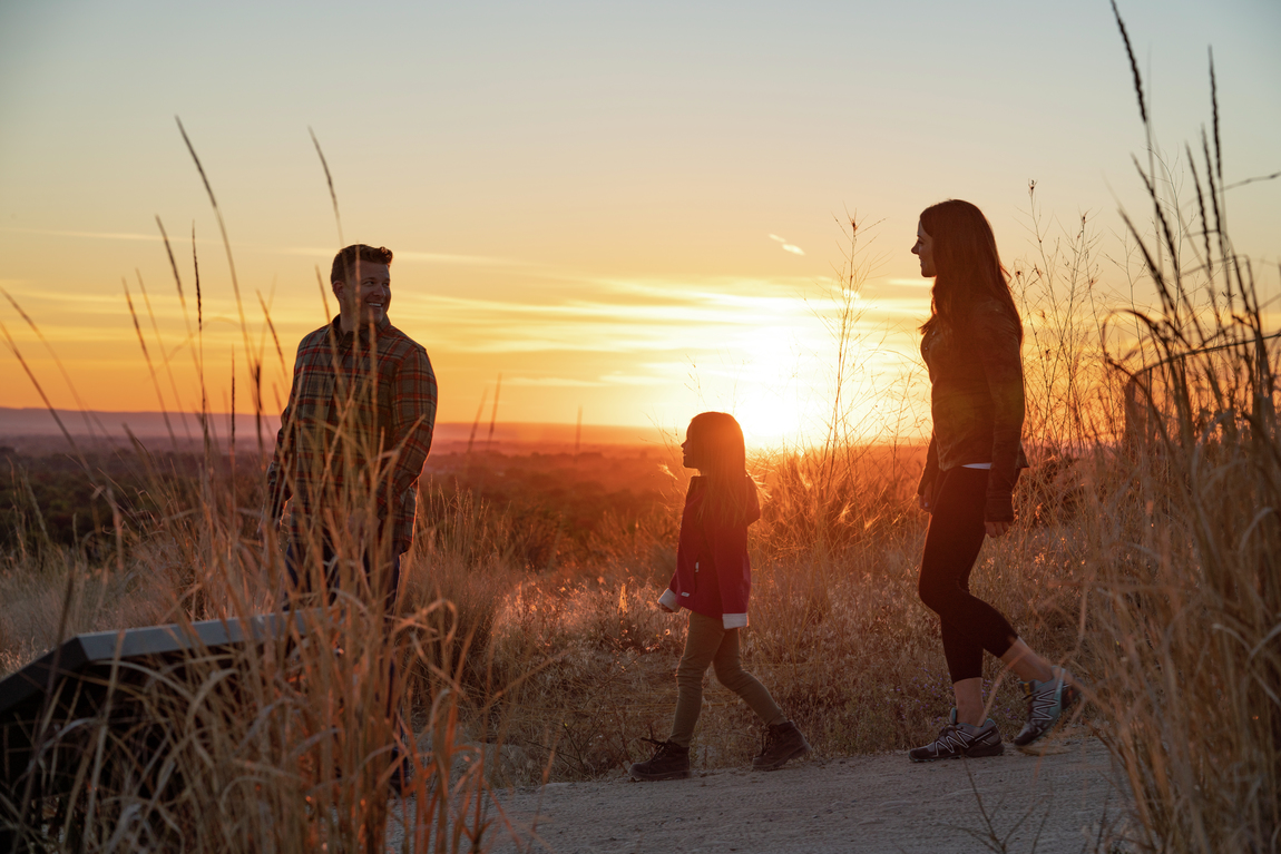 Family hiking and enjoying surrounding environment of The Oaks North
