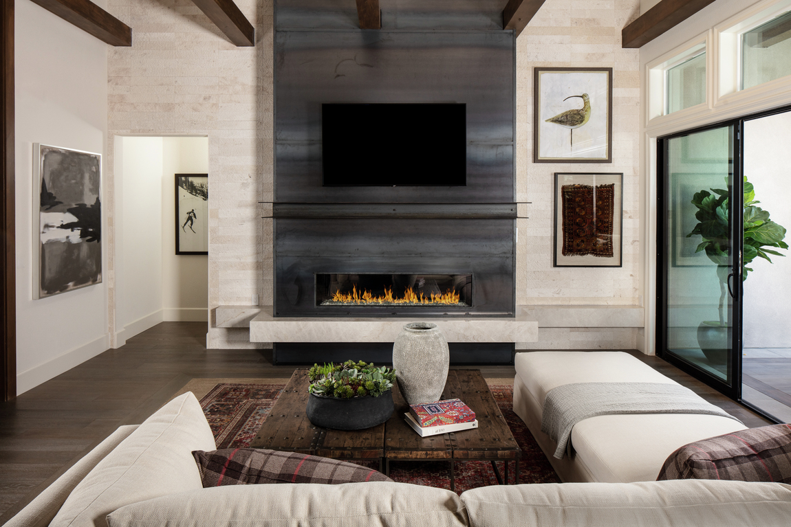 A contemporary fireplace in a small living room.