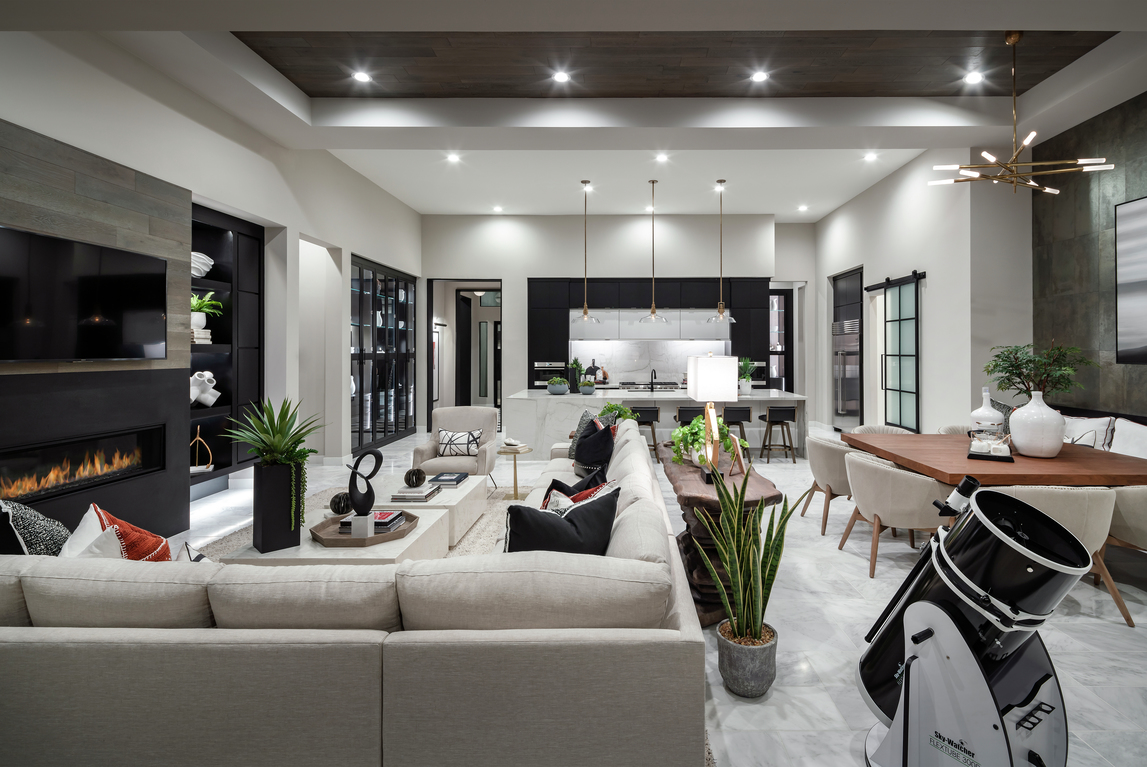 Expansive open-concept interior elevated by ceiling accents