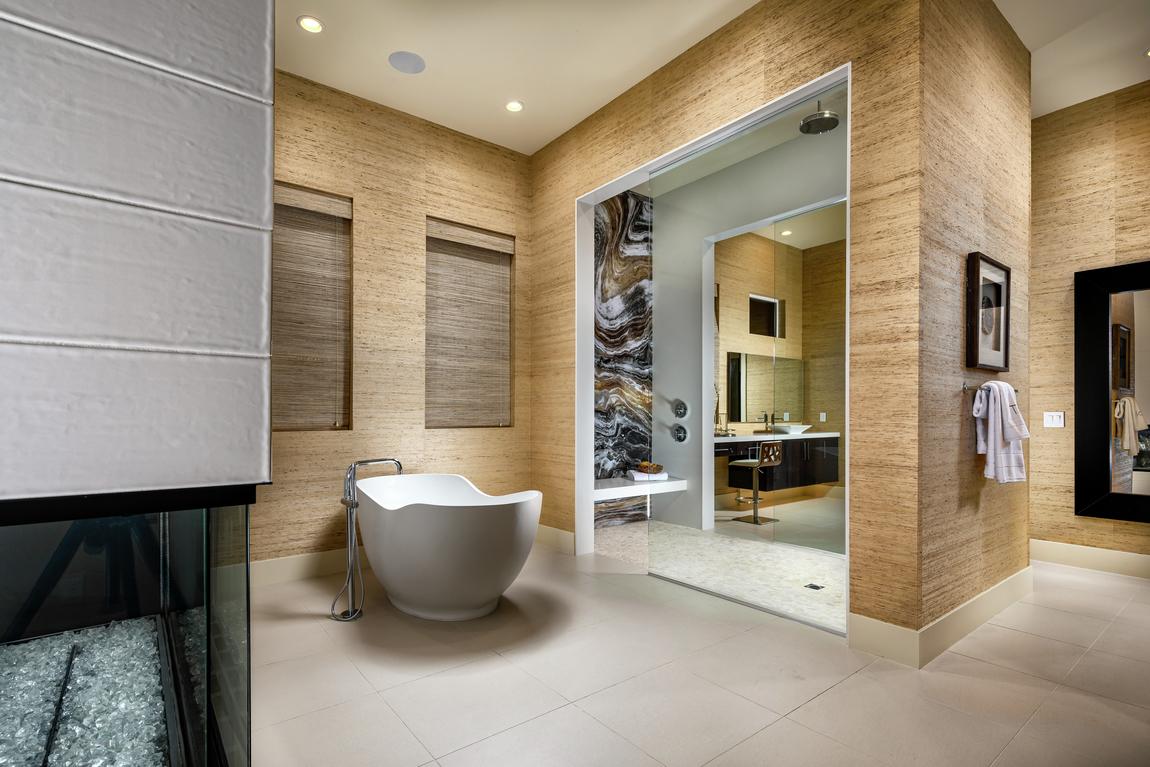 Large bathroom with a rain head shower and a freestanding bathtub.