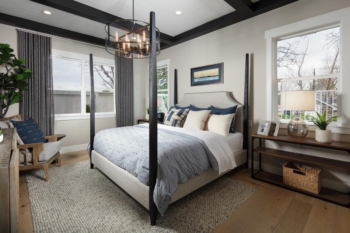 Elegant bedroom highlighted by chandelier