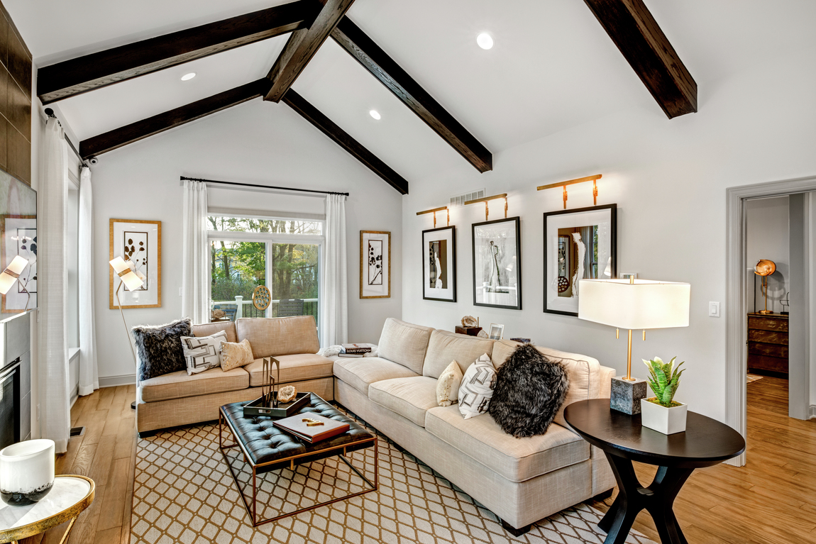 A farmhouse style great room with a vaulted ceiling