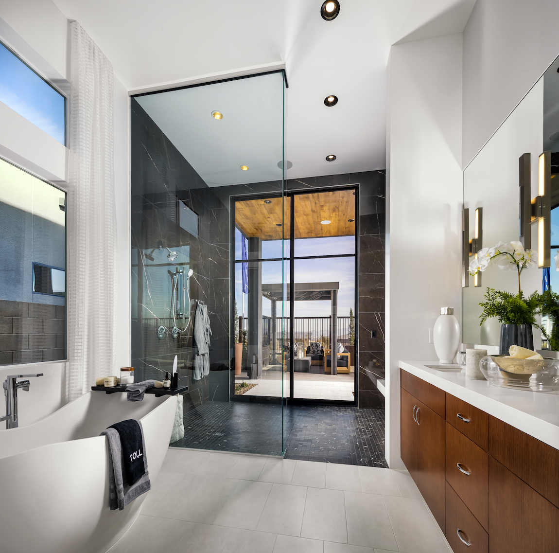 Primary bathroom with a black tile shower.