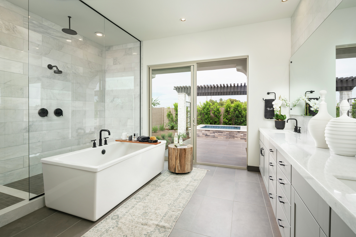 Bathroom with a sliding door that opens to an outdoor patio.