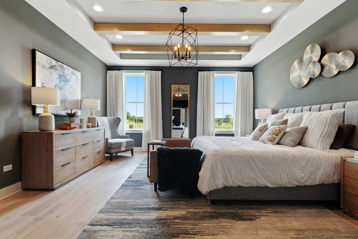 bedroom with tray beam ceiling