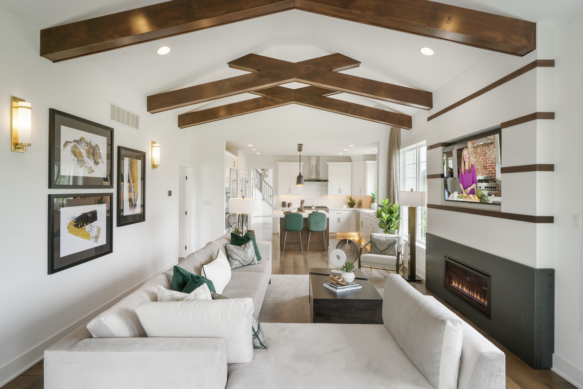 great room accented by vaulted wood beam ceiling
