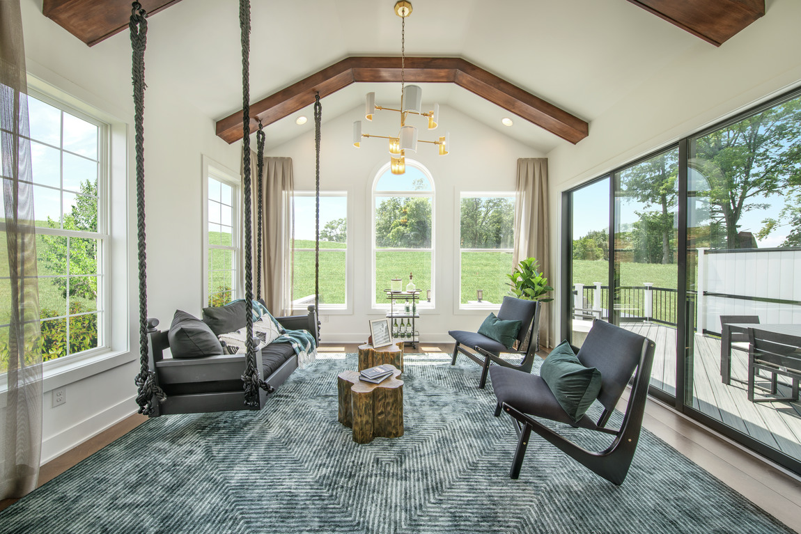 Sunroom with faulted wood beam ceiling