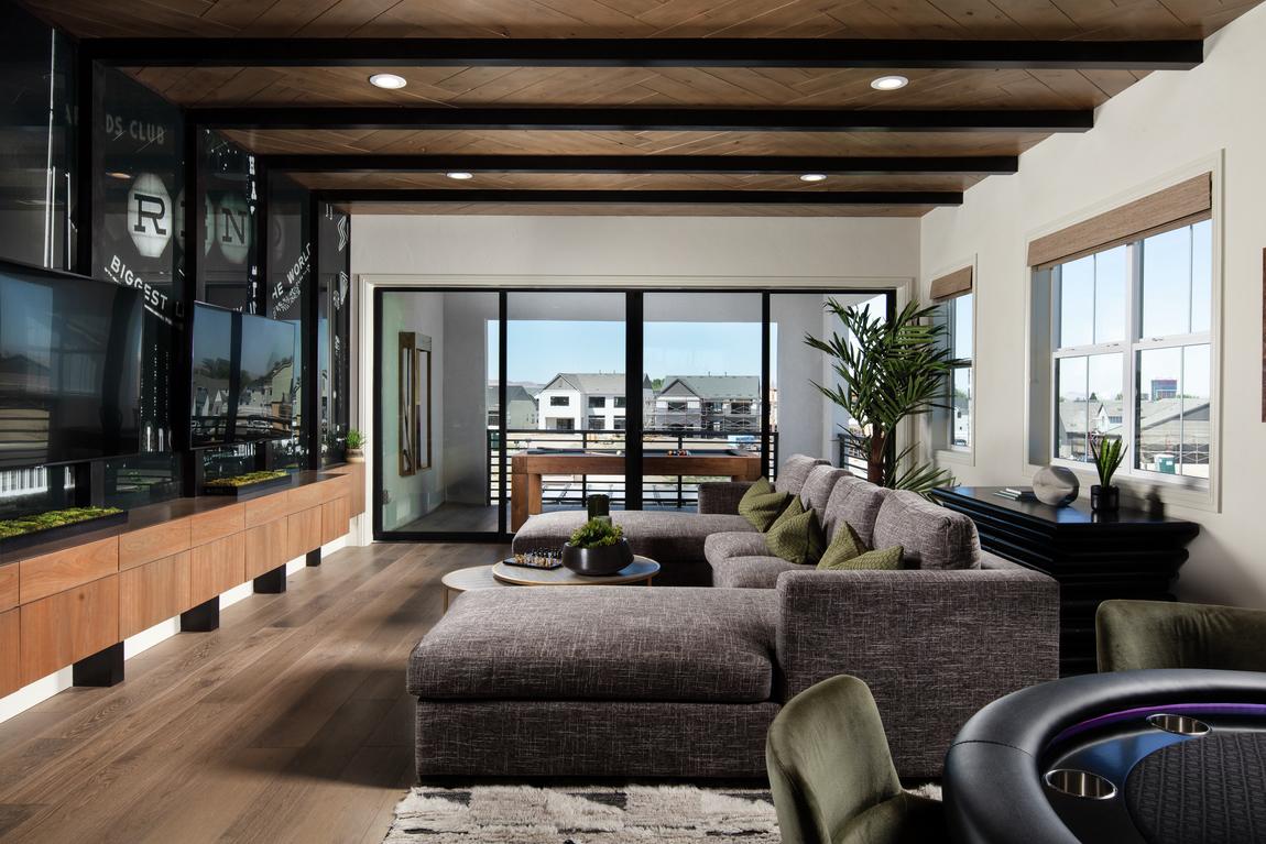 loft with wood beam ceilings