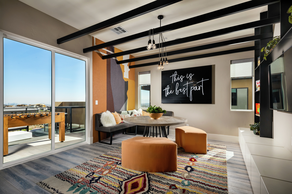 bonus room with black wood beam ceilings