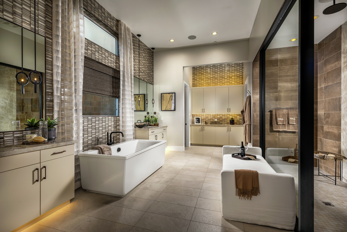 luxury bathroom with sleek tile and accent lighting