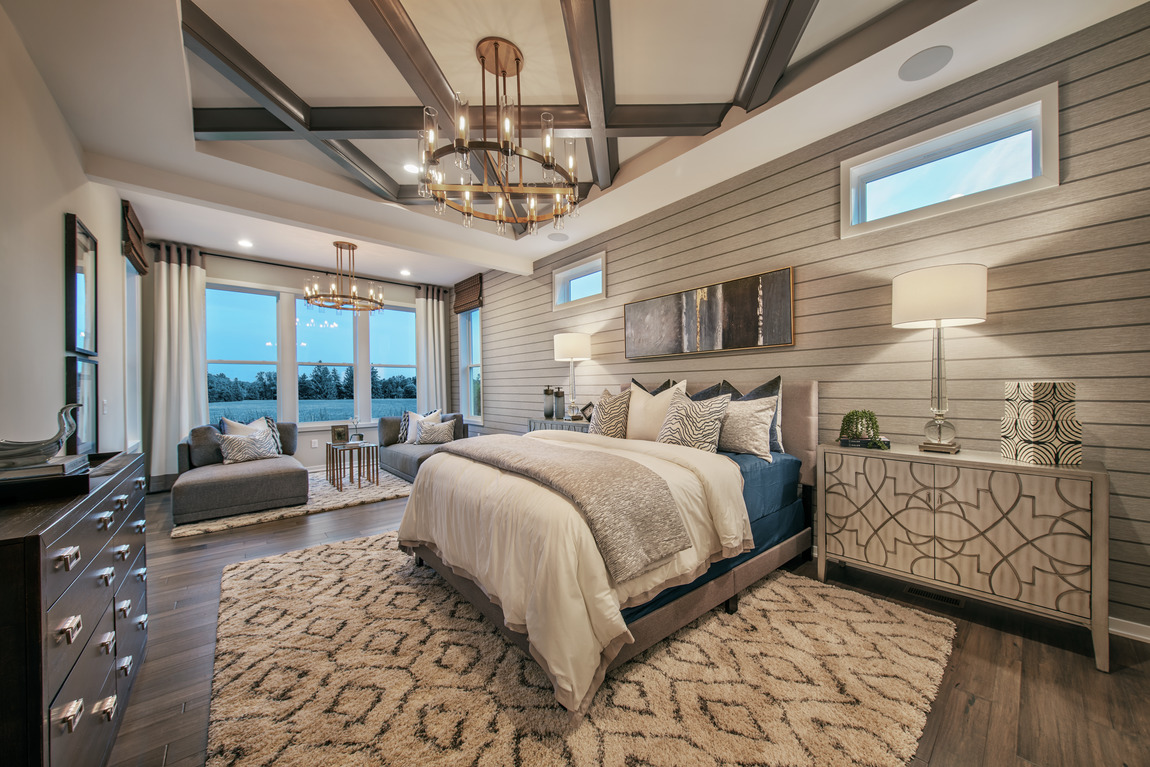 traditional bedroom design with wood beams