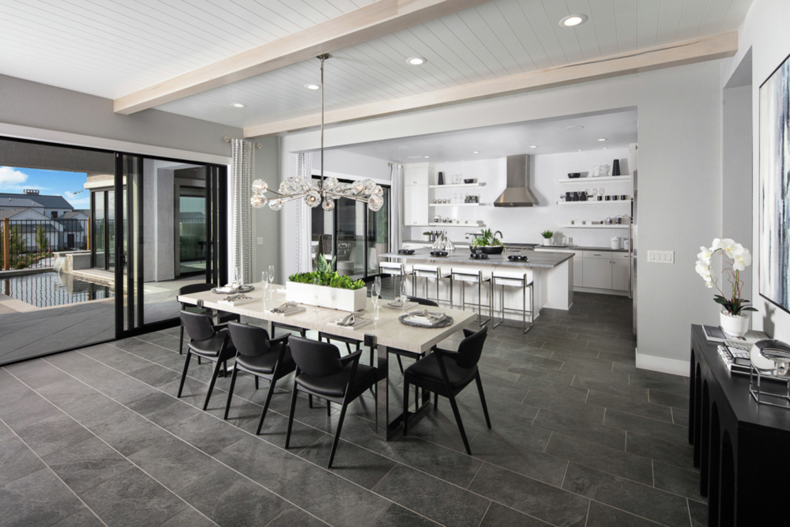 modern great room and kitchen design with wood beam ceilings