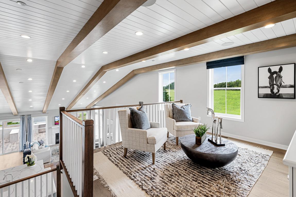 Loft featuring wood beams
